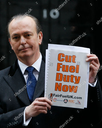 Quentin Wilson Quentin Wilson, national spokesman for Fair Fuel UK holds up a copy of a report justifying a cut in fuel duty, at Downing Street in London