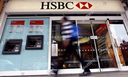 "A pedestrian passes a branch of HSBC bank in London. The chair of parliaments Public Accounts Committee says the former chief of HSBC must face serious questions after once-secret papers outlined how the bank helped the wealthy dodge taxes. Margaret Hodge told the BBC on that Stephen Green, HSBC's former CEO, was either ""asleep at the wheel, or he did know and he was therefore involved in dodgy tax practices"