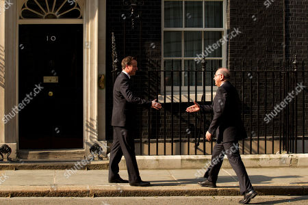 Stock Picture of Britain's Prime Minister David Cameron, left, greets Libya's Prime Minister, Abdurrahim el-Keib before their meeting at 10 Downing Street in London