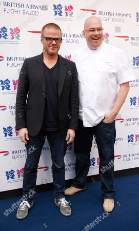 "British celebrity chef Heston Blumenthal, left with colleague Simon Hulstone in London, Tuesday, April, 3, 2012, as they highlight their part in a British Airways Olympic promotion. Artist Tracey Emin mentored designer Pascal Anson, who created the look of the plane. Emin said she loved the design, which ""brings back the excitement of travel.""The planes are one of several Olympic-themed projects for British Airways designed to celebrate British creative talent. Chef Heston Blumenthal is helping colleague Simon Hulstone develop in-flight meals inspired by traditional British cookery and the 1948 London Olympics, and actor Richard E. Grant has helped writer Prasanna Puwanarajah script a short film to be shown on flights. British Airways will fly the Olympic flame from Greece to south west Britain where it will start is journey round Britain on May 18 to reach the Olympic Stadium for the opening ceremony on July 27"