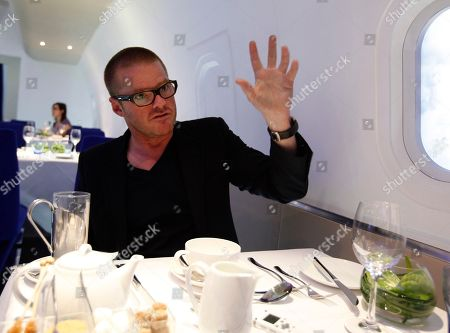 "Stock Image of British celebrity chef Heston Blumenthal gestures as he talks to the Associated Press in a mock up plane about his role in developing food for the London 2012 Olympic plane, in London, Tuesday, April, 3, 2012. Artist Tracey Emin mentored designer Pascal Anson, who created the look of the plane. Emin said she loved the design, which ""brings back the excitement of travel.""The planes are one of several Olympic-themed projects for British Airways designed to celebrate British creative talent. Chef Heston Blumenthal is helping colleague Simon Hulstone develop in-flight meals inspired by traditional British cookery and the 1948 London Olympics, and actor Richard E. Grant has helped writer Prasanna Puwanarajah script a short film to be shown on flights. British Airways will fly the Olympic flame from Greece to south west Britain where it will start is journey round Britain on May 18 to reach the Olympic Stadium for the opening ceremony on July 27"
