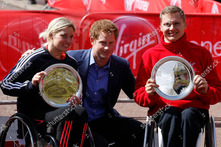Prince Harry, David Weir, Shelly Woods Britain's Prince Harry, center, poses with men and women wheelchair winners Britain's David Weir, right, and Britain's Shelly Woods during the presentation in the London Marathon, London