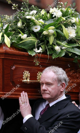 Martin McGuinness Northern Ireland Deputy First Minister Martin McGuinness carries the coffin of comedian Frank Carson after a funeral mass at St Patrick's Catholic Church in Belfast, Northern Ireland