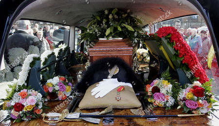 The coffin of comedian Frank Carson is seen in a Hearse outside St Patrick's Catholic Church in Belfast, Northern Ireland