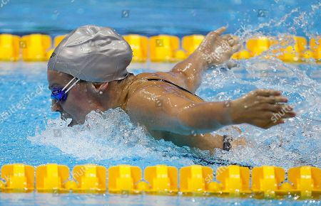 Britain's Ellen Gandy on her way to win the women's 200 meter butterfly semi-final during the British Swimming Championship selection trials and Olympic test event at the London 2012 Olympic Aquatics Center at the Olympic Park in London, . A number of international swimmers have been invited to attend the championships and compete in guest finals