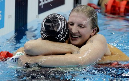 Olympic double gold medalist Britain's Rebecca Adlington, right, celebrates winning gold with silver medalist Joanne Jackson, left, after the final of the women's 400m freestyle during the British Swimming Championship selection trials and Olympic test event at the London 2012 Olympic Aquatics Centre at the Olympic Park in London, . A number of international swimmers have been invited to attend the championships and compete in guest finals