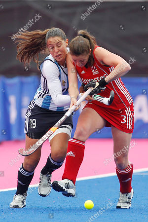 Emily Maguire, Sofia Maccari Britain's Emily Maguire, right, competes with Argentina's Sofia Maccari during the women's gold medal field hockey match between Britain and Argentina at the Riverbank field hockey arena in the Olympic Park in London