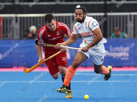 James Tindall, Sardar Singh Britain's James Tindall, left, competes with India's Sardar Singh during the men's bronze medal field hockey match between Britain and India at the Riverbank field hockey arena in the Olympic Park in London