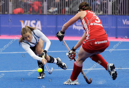 Delfina Merino, Emily Maguire Argentina's Delfina Merino, left, attempts a shot pass Britain's Emily Maguire during the women's gold medal field hockey match between Britain and Argentina at the Riverbank field hockey arena in the Olympic Park in London