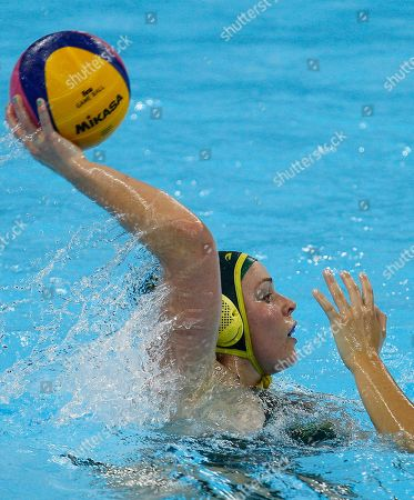 Australia's Nicola Zagame passes the ball under pressure from Margaret Steffens of the US, during the gold medal game of the invitational international Water Polo test event at the London 2012 Olympics Water Polo pool at the Olympics park in London, . The U.S, Australia, Hungary and Britain are competing in this test event ahead of the upcoming summer Olympic Games in London