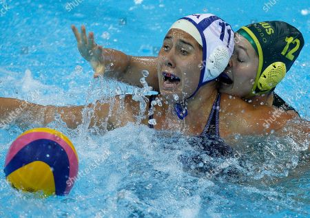 Annika Dries of the US, left, reacts as Australia's Nicola Zagame collides with her during the gold medal match of the invitational international Water Polo test event at the London 2012 Olympics Water Polo pool at the Olympics park in London, . The U.S. and Australia are competing in this test event ahead of the upcoming summer Olympic Games in London