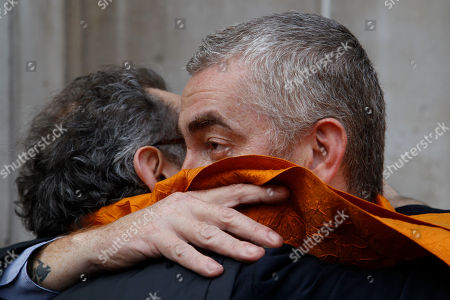 Alex Atala, right, head chef at D.O.M. in Sao Paolo, Brazil, embraces chef Massimo Bottura as they arrive for the 2012 World's 50 Best Restaurant Awards, in central London, . The World's 50 Best Restaurants list is an annual snapshot of the opinions and experiences of over 800 international restaurant industry experts