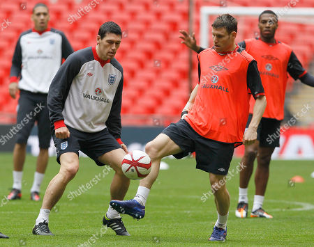 Gareth Barry, James Milner England's Gareth Barry, left, and James Milner during a training session at Wembley Stadium, London,. England will play a friendly soccer match against the Netherlands on Wednesday Feb. 29 at Wembley Stadium