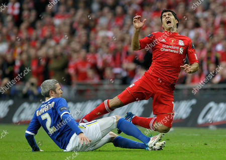 Kevin McNaughton, Luis Suarez Cardiff City's Kevin McNaughton, left, tackles Liverpool's Luis Suarez during their English League Cup final soccer match at Wembley Stadium, London