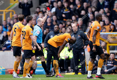 Wolverhampton Wanderers' Ronald Zubar, centre, is shown a red card by referee Anthony Taylor after a tackle on Manchester United's Danny Welbeck during their English Premier League soccer match at Molineux Stadium, Wolverhampton, England
