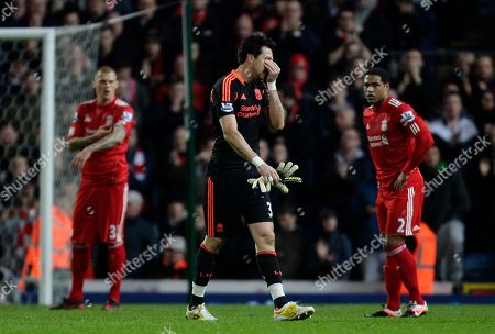 Liverpool's goalkeeper Alexander Doni, centre, holds his face as he walks from the pitch after being sent off during is team's English Premier League soccer match against Blackburn at Ewood Park Stadium, Blackburn, England