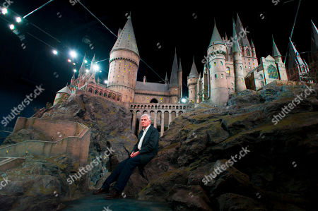 Stock Picture of Stuart Craig Stuart Craig, production manager, unveils a model of Hogwarts castle at the Warner Bros Studio Tour, Watford, London, . The Hogwarts castle model was built for the first film 'Harry Potter and the Philosopher's Stone', it was created for aerial photography and was digitally scanned for CGI scenes. It took 86 artists and crew members to construct, it measures over 50 feet in diameter and has over 2,500 fibre optic lights