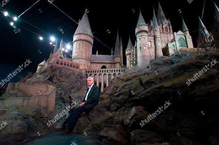 Stuart Craig, production manager, unveiles a model of Hogwarts castle at the Warner Bros Studio Tour, Watford, London. The Hogwarts castle model was built for the first film Harry Potter and the Philosopher's Stone, it was created for aerial photography and was digitally scanned for CGI scenes. It took 86 artists and crew members to construct, measures over 50 feet in diameter and has over 2,500 fibre optic lights