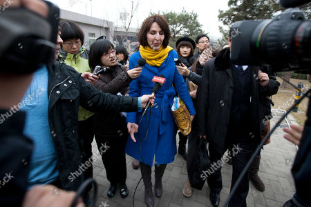 "Kim Lee Kim Lee, center, wife of ""Crazy English"" founder Li Yang, is surrounded by local journalists as she walks into a court for her divorce trial in Beijing, China. A Beijing court has granted a divorce to the American woman and her Chinese celebrity-entrepreneur husband Li Yang in a high-profile case that highlighted the often-hidden problem of domestic violence in China. The official Xinhua News Agency said the divorce was granted, on the grounds of domestic abuse and the court approved Lee's request for a three-month restraining order against Li"