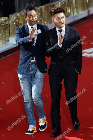 Stock Image of Simon Yam, Alec Su Hong Kong actor Simon Yam, left, and Taiwanese actor Alec Su arrive at the Beijing International Film Festival in Beijing, China