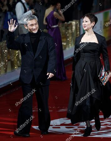 Tsui Hark, Nansun Shi Hong Kong flim director Tsui Hark, left, and his wife Nansun Shi arrive at the Beijing International Film Festival in Beijing, China