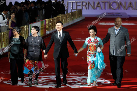 Andy Lau, Deanie Ip, Ann Hui Hong Kong actor Andy Lau, center, actress Deanie Ip, second right, and director Ann Hui, second left, arrive at the Beijing International Film Festival in Beijing, China