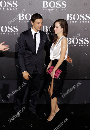 German actor Florian David Fitz and his close friend Anja Knauer arrive for the Hugo Boss Black Fashion Show held in Beijing, China