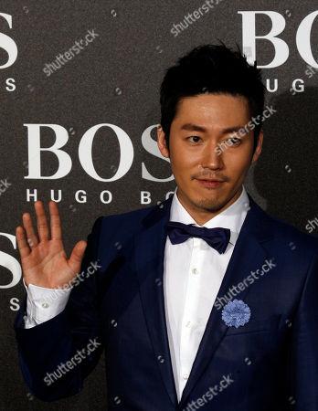 South Korean actor Jang Hyuk arrives for the Hugo Boss Black Fashion Show held in Beijing, China