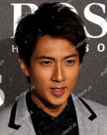 Chinese actor Wu Chun arrives for the Hugo Boss Black Fashion Show held in Beijing, China