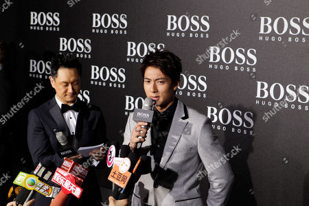 Chinese actor Wu Chun speaks to journalists at the Hugo Boss Black Fashion Show held in Beijing, China
