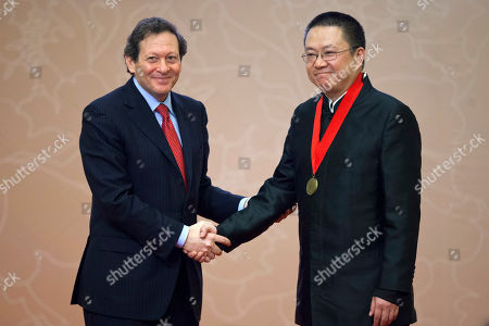 Thomas J. Pritzker, Wang Shu Thomas J. Pritzker, chairman of the Hyatt Foundation, left, shakes hands with Chinese architect Wang Shu at the Pritzker Architecture Prize award ceremony at the Great Hall of the People in Beijing, China, . When Wang accepts his field's richest prize in a ceremony Friday at the seat of China's legislature, a symbolic second winner will be waiting in the background - Hyatt Hotels
