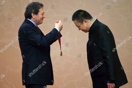 Thomas J. Pritzker, Wang Shu Thomas J. Pritzker, chairman of the Hyatt Foundation, left, gives a medal to Chinese architect Wang Shu at the Pritzker Architecture Preize award ceremony at the Great Hall of the People in Beijing, China, . When Wang accepts his field's richest prize in a ceremony Friday at the seat of China's legislature, a symbolic second winner will be waiting in the background - Hyatt Hotels