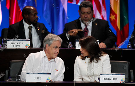 Stock Picture of Presidents Sebastian Pinera of Chile, and Laura Chinchilla of Costa Rica visit at the opening ceremony of the sixth Summit of the Americas at the Convention Center in Cartagena, Colombia, . The summit brings together presidents and prime ministers from Canada, the Caribbean, Latin America and the U.S. Pictured in back row are Prime Ministers Denzil Llewellyn Douglas of Saint Kitts and Nevis, left, and Ralph Gonsalves of Saint Vincent and the Grenadines