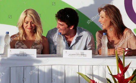 Colombia's singer Shakira, left, Colombian businessman Alejandro Santo Domingo, center, and Colombia's first lady Maria Clemencia Rodriguez attend the inauguration of a child care center in Cartagena, Colombia, . Shakira will sing the National Anthem of Colombia during the opening ceremony of the 6th Summit of the Americas in Cartagena on April 14