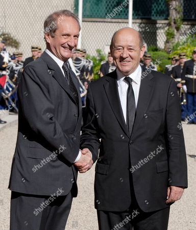 Gerard Longuet, Jean-Yves Le Drian France outgoing Defense Minister, Gerard Longuet, left, shakes hands with France's new Defense Minister Jean-Yves Le Drian during the handover ceremony in Paris