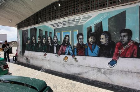 Mural mimicking The Last Supper religious painting covers a wall in the commercial area of a popular housing complex, showing from left to right, Colombia's FARC leader Manuel Marulanda, Cuba's Fidel Castro, Cuba's revolutionary hero Ernesto 'Che' Guevara, China's Mao Tse-tung, Russia's Vladimir Lenin, Germany's Karl Marx, Jesus Christ, Venezuela's late independence hero Simon Bolivar, Venezuelan rebel fighters Alexis Gonzalez and Fabricio Ojeda and Venezuela's President Hugo Chavez in Caracas, Venezuela, . Chavez revealed Sunday that a new tumor recently removed from his pelvic region was of the same type of cancer as a baseball-sized growth extracted from that part of his body about eight months ago