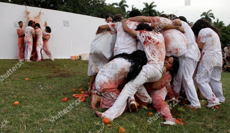 """Students of the Superior Art Institute perform """"Jesus Against The Universe"""" by the Austrian artist Hermann Nitsch as part of the 11th Havana Biennial contemporary art exhibition in Havana, Cuba"""