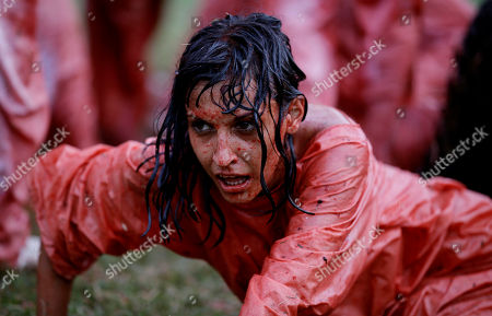 """A student of the Superior Art Institute participates in the performance of """"Jesus Against The Universe"""" by the Austrian artist Hermann Nitsch as part of the 11th Havana Biennial contemporary art exhibition in Havana, Cuba"""