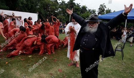 """Austrian artist Hermann Nitsch, right, and students of the Superior Art Institute perform """"Jesus Against The Universe"""" as part of the 11th Havana Biennial contemporary art exhibition in Havana, Cuba, Mondday"""