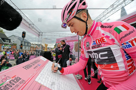 Taylor Phinney Taylor Phinney, of the United States, wears the overall leader's pink jersey as he signs the starting list, prior to the second stage of the Giro d'Italia, Tour of Italy cycling race, in Herning, Denmark, . American Taylor Phinney won the first stage of the Giro d'Italia, an 8.7-kilometer (5.4-mile) individual time trial in Herning on Saturday. Phinney became the first American to wear the pink jersey since Christian Vande Velde in 2008 when Garmin won the opening team time trial in Palermo
