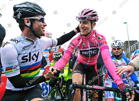 Taylor Phinney, Mark Cavendish Taylor Phinney, of the United States, right, is congratulated by Britain's Mark Cavendish, prior to the second stage of the Giro d'Italia, Tour of Italy cycling race, in Herning, Denmark, . American Taylor Phinney won the first stage of the Giro d'Italia, an 8.7-kilometer (5.4-mile) individual time trial in Herning on Saturday. Phinney became the first American to wear the pink jersey since Christian Vande Velde in 2008 when Garmin won the opening team time trial in Palermo