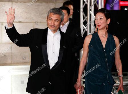 Tsui Hark, Shi Nansun Hong Kong director Tsui Hark, left and his wife Shi Nansun pose on the red carpet of the 31st Hong Kong Film Awards in Hong Kong