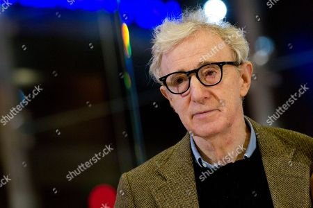 "Director and actor Woody Allen poses on the red carpet of the movie ""To Rome with Love,"" in Rome. Woody Allen is returning to France for his next film, and he's bringing Colin Firth and Emma Stone along as its stars. Producers Letty Aronson and Stephen Tenenbaum announced, that Allen is set to start shooting his untitled new comedy this summer"