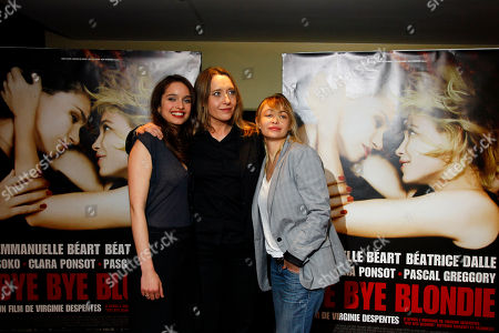 """Clara Ponsot, Virginie Despentes, Emmanuelle Beart Actress Clara Ponsot, French Director Virginie Despentes, and actress Emmanuelle Beart, from left to right, arrive for the screening of """"Bye Bye Blondie"""" by French Director Virginie Despentes in Paris"""