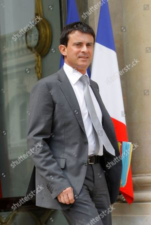 French Interior Minister Manuel Vals, leaves after his weekly cabinet meeting in Elysee Palace, Paris