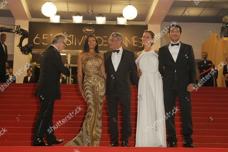 Stock Picture of Thierry Fremaux, Yousry Nasrallah, Nahed El Sebai, Menna Shalaby, Bassem Samra From left artistic director Thierry Fremaux, actress Nahed El Sebai, director Yousry Nasrallah, actors Menna Shalaby and Bassem Samra arrive for the screening of After the Battle at the 65th international film festival, in Cannes, southern France
