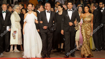 Yousry Nasrallah, Nahed El Sebai, Menna Shalaby, Bassem Samra In the foreground from left, actress Menna Shalaby, director Yousry Nasrallah, actors Bassem Samra and Nahed El Sebai arrive for the screening of After the Battle at the 65th international film festival, in Cannes, southern France
