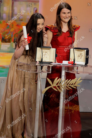 Cristina Flutur, Cosmina Stratan Actresses Cristina Flutur, right, and Cosmina Stratan are jointly awarded the Best Actress award for Beyond the Hills by actor Alec Baldwin, right, during the awards ceremony at the 65th international film festival, in Cannes, southern France