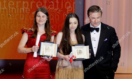 Cristina Flutur, Cosmina Stratan, Alec Baldwin Actresses Cristina Flutur, left, and Cosmina Stratan, center, are jointly awarded the Best Actress award for Beyond the Hills by actor Alec Baldwin, right, during the awards ceremony at the 65th international film festival, in Cannes, southern France