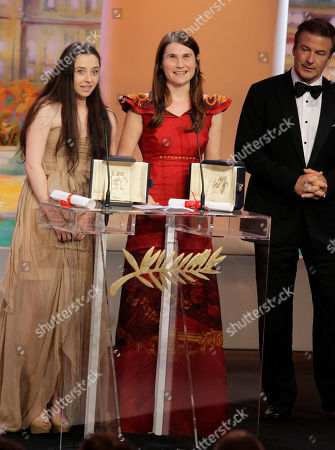 Cristina Flutur, Cosmina Stratan, Alec Baldwin Actresses Cristina Flutur, center, and Cosmina Stratan, left, are jointly awarded the Best Actress award for Beyond the Hills by actor Alec Baldwin, right, during the awards ceremony at the 65th international film festival, in Cannes, southern France
